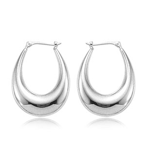 Silver Earrings by Carla Corporation